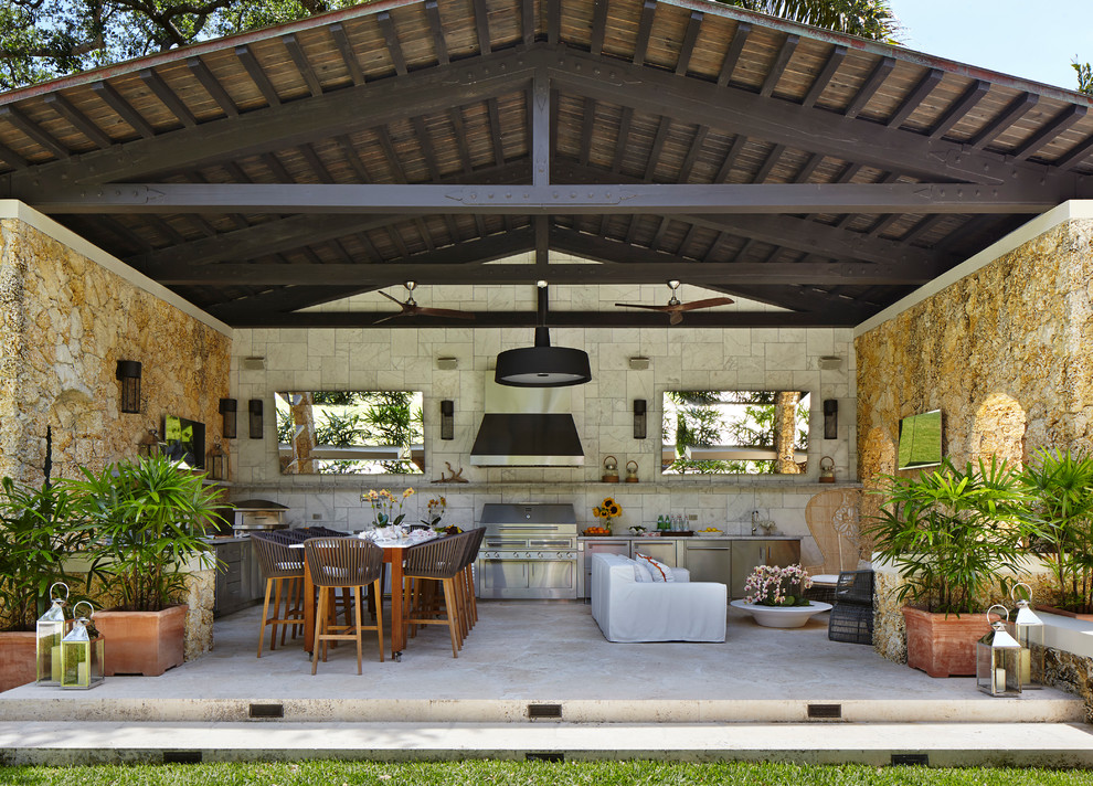 Tuscan stone patio kitchen photo in Chicago with a roof extension