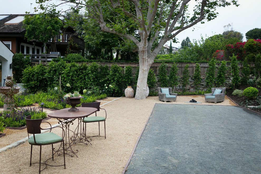Example of a large classic backyard patio design in Orange County with no cover