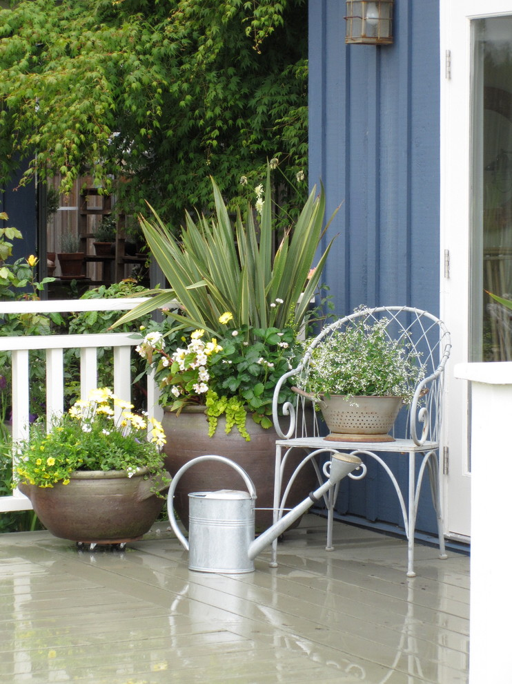 Inspiration for a timeless patio remodel in Vancouver with decking
