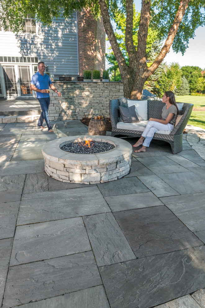 Couple Enjyoing Their Unilock Rivercrest Wall Firepit Kit And Natural Stone Pati Contemporary Patio Other By Unilock
