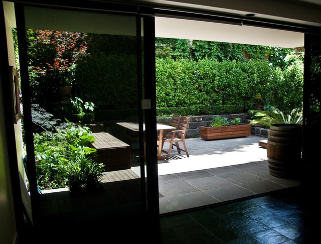 Courtyard in sawn and hewn bluestone with yellow box for Courtyard landscaping melbourne