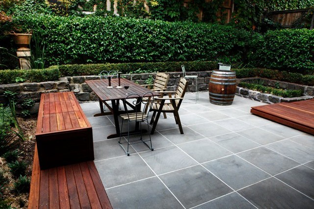 Courtyard in sawn and hewn bluestone with yellow box for Courtyard designs melbourne