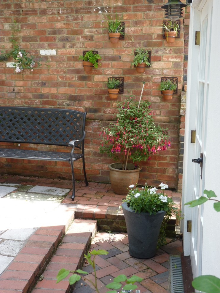 Courtyard Of Period Cottage Rye, Patio Brick Wall Ideas