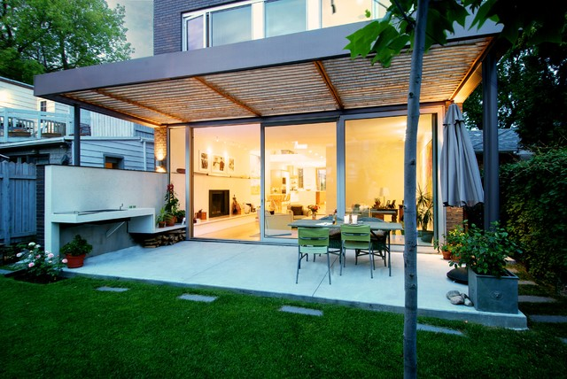 Example Of A Trendy Patio Design In Toronto With A Pergola