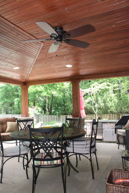 Covered patio brecksville for Rustic covered decks