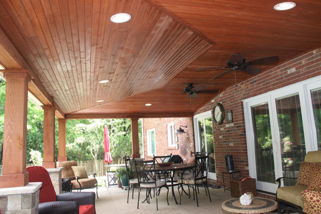 Covered patio with can lights and vaulted ceiling rustic for Balcony ceiling design