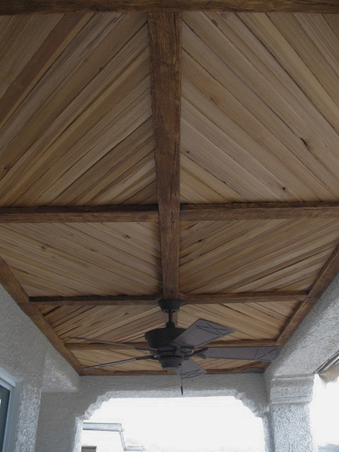 covered patio with faux wood beam and plank ceiling