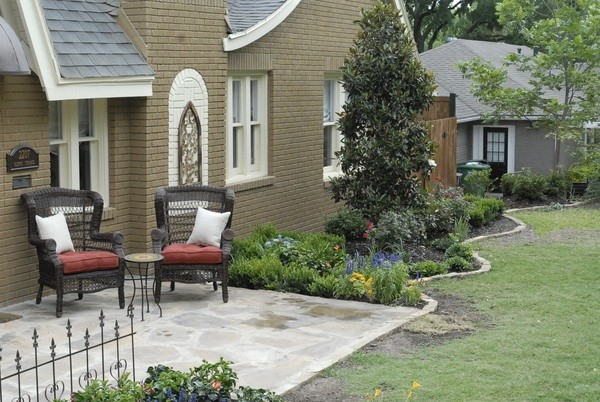 Example of a mid-sized arts and crafts front yard stone patio design in Dallas