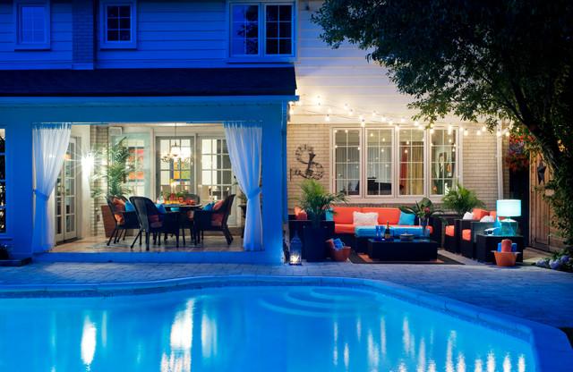 Patio - large tropical backyard patio idea in Toronto