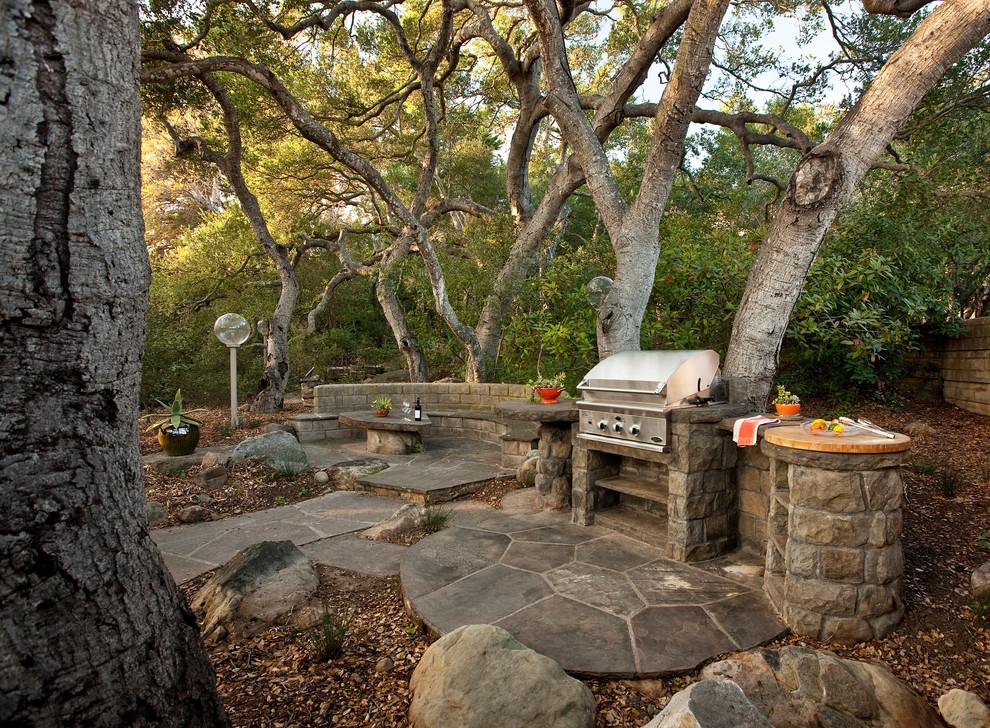 Example of a classic stone patio design in Santa Barbara with no cover