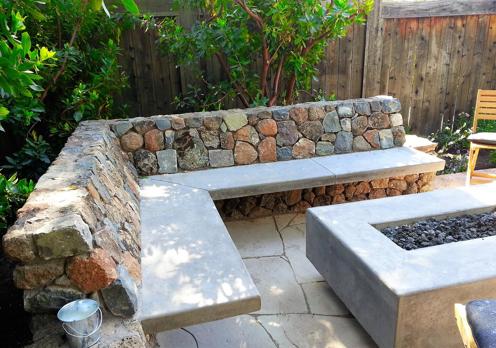 Inspiration for a small craftsman backyard stone patio remodel in San Francisco with a fire pit
