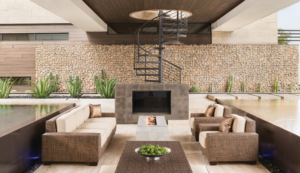 Huge trendy backyard patio photo in Las Vegas with a fire pit