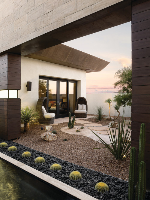 Cacti are perfect for lining areas, as they are easy to control and predict. These Cacti are in a stone bed lining this outdoor patio area, and are a perfect element for bringing a bit of vibrancy and life to a feature like this.