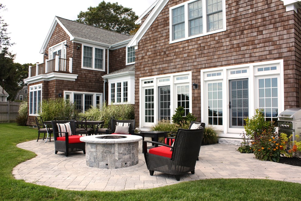 Patio - coastal backyard patio idea in Boston with a fire pit