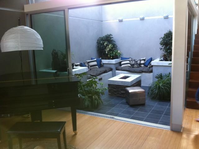 Custom Inner Atrium with fire feature contemporary-patio