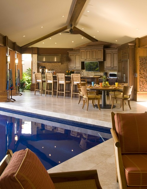 Example of a large island style backyard tile patio kitchen design in Hawaii with no cover
