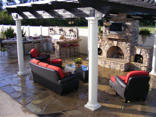 Custom outdoor kitchen and fireplace traditional patio for Traditional outdoor kitchen designs
