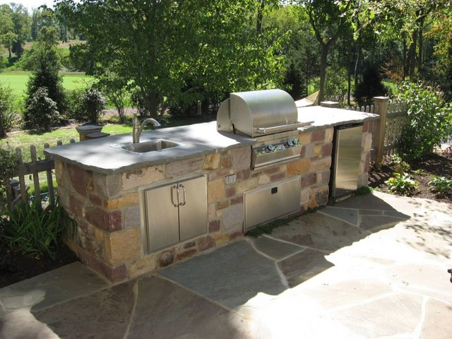 Custom outdoor kitchen with flagstone patio traditional for Traditional outdoor kitchen designs