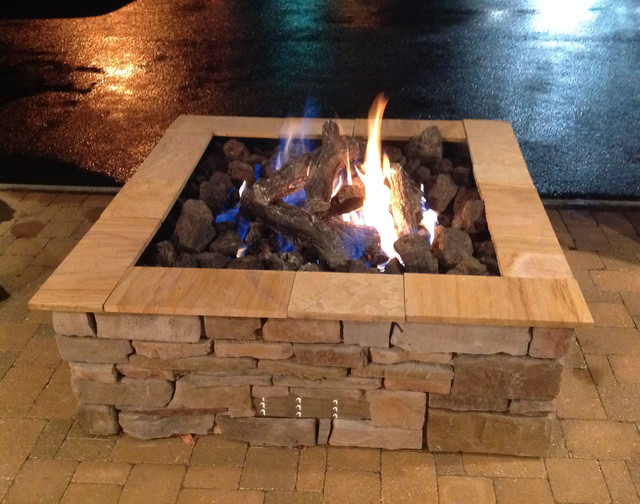 Custom square outdoor gas log fire pit by Fines Gas Rustic