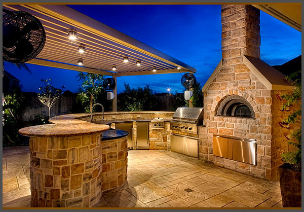 Custom summer kitchen featuring wood burning pizza oven for Outdoor summer kitchen ideas