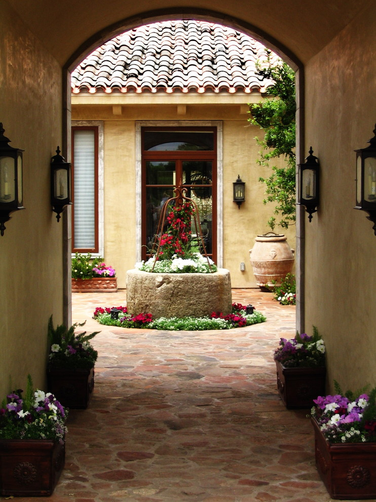 Example of a tuscan courtyard patio design in Vancouver