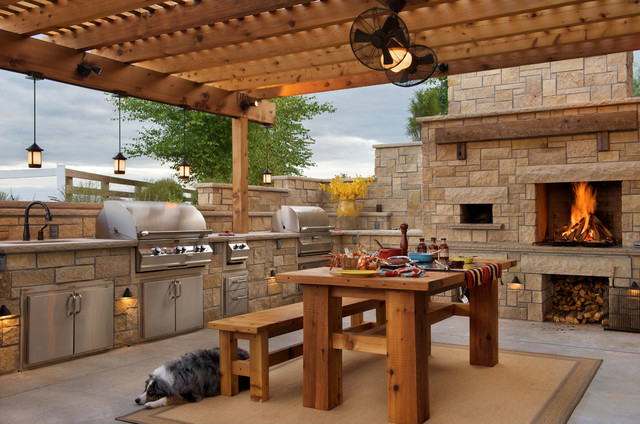 Mid-sized farmhouse backyard concrete patio kitchen photo in Kansas City with a pergola