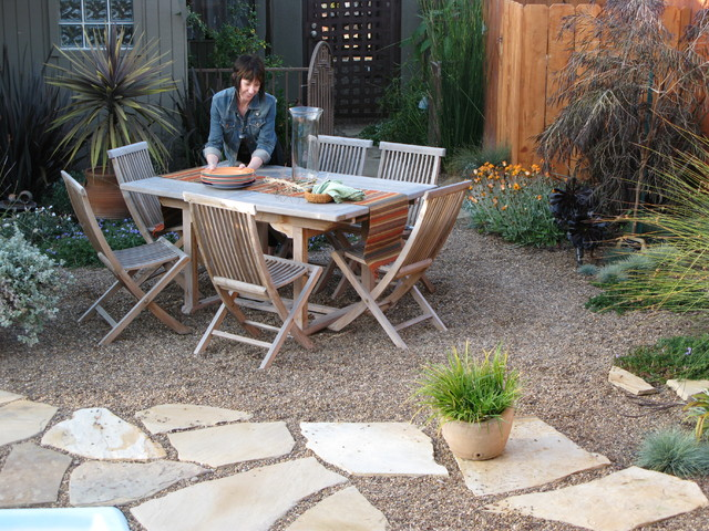 Pair stone or gravel with bigger pavers for a patio design that ...