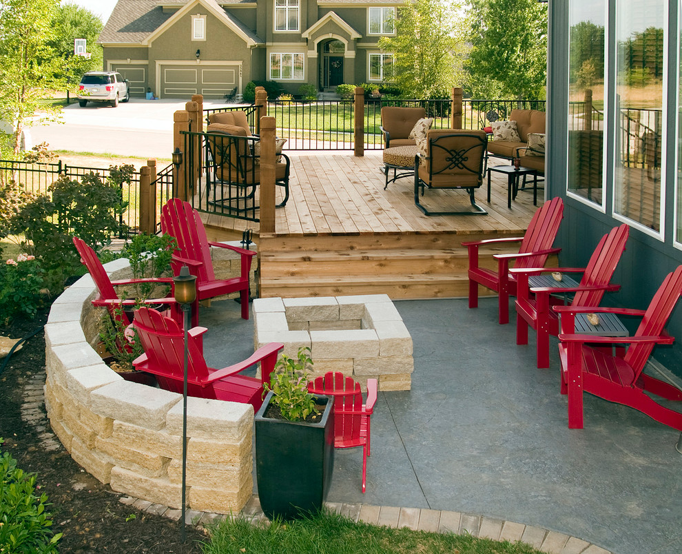 Inspiration for a timeless patio remodel in Kansas City with decking