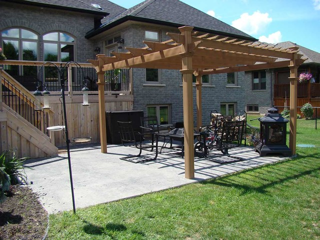 Backyard With Pergola decorative stamped concrete patio with pergola - traditional - patio