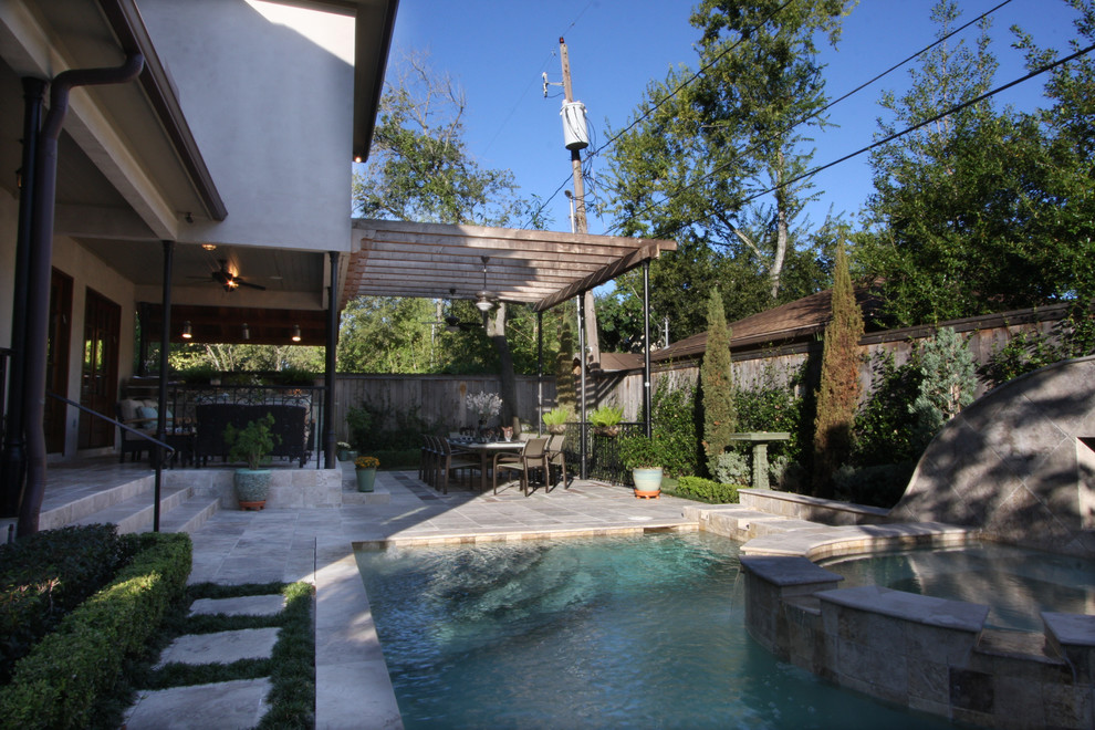 Transitional patio photo in Houston with a pergola