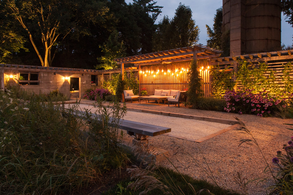 Inspiration for a mid-sized cottage side yard gravel patio remodel in Chicago with a pergola