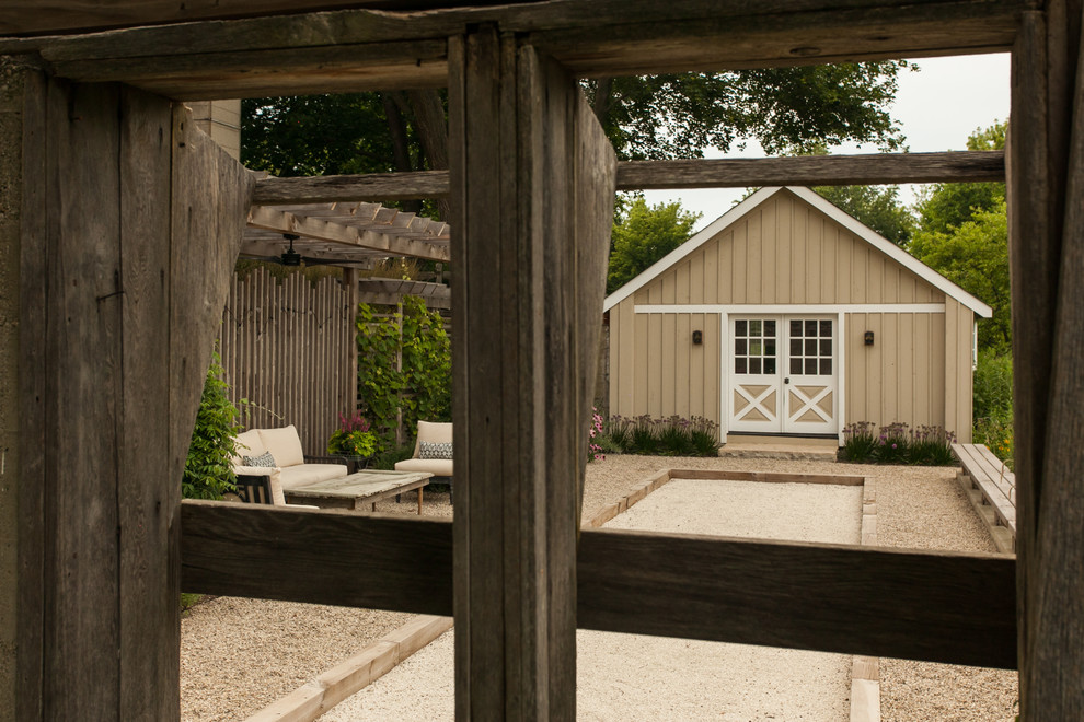 Patio - mid-sized cottage side yard gravel patio idea in Chicago with a pergola