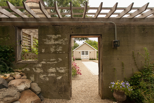 Inspiration for a mid-sized country side yard gravel patio remodel in Chicago with a pergola