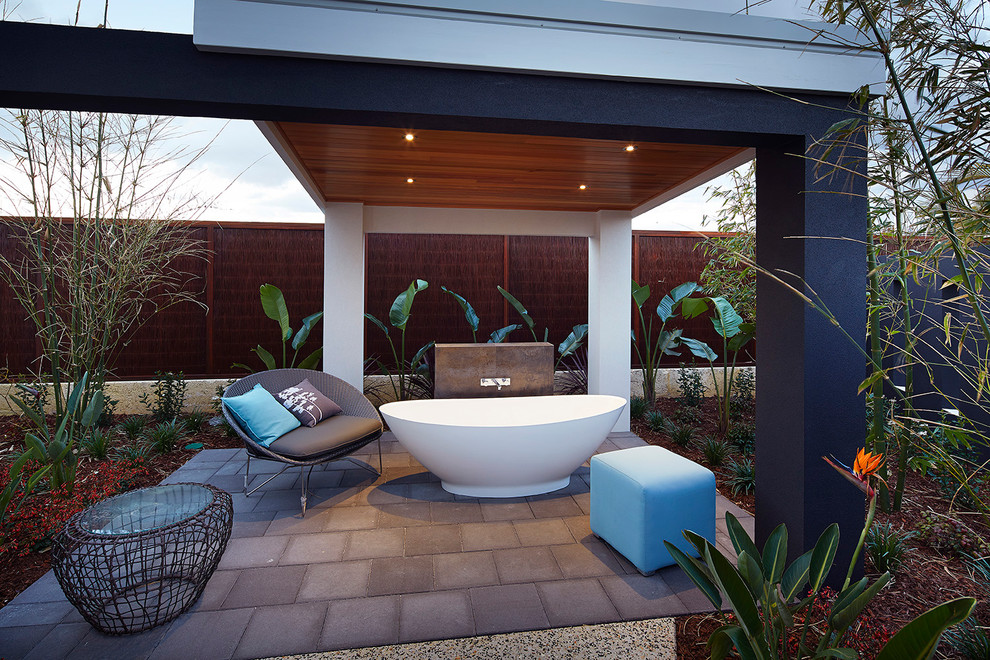 Inspiration for a contemporary backyard stone patio remodel in Perth