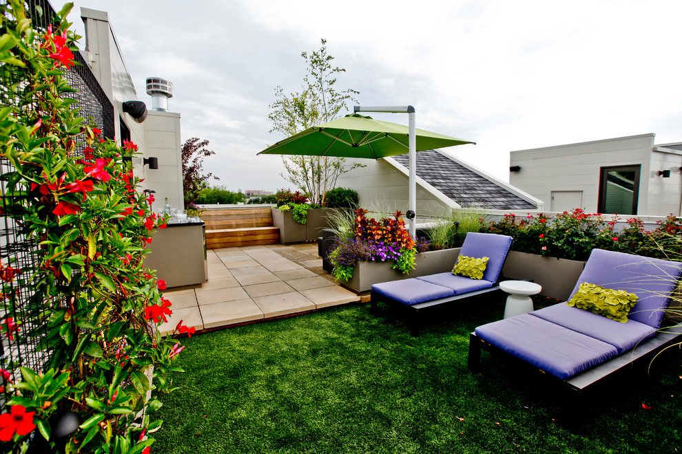Patio - contemporary patio idea in Chicago with a fire pit
