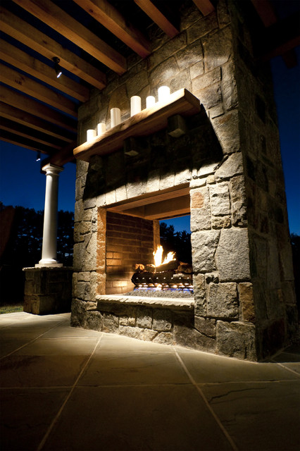 Double opening stone fireplace traditional-patio