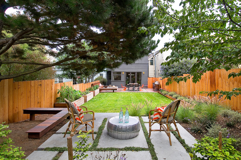Example of a trendy backyard concrete paver patio design in San Francisco