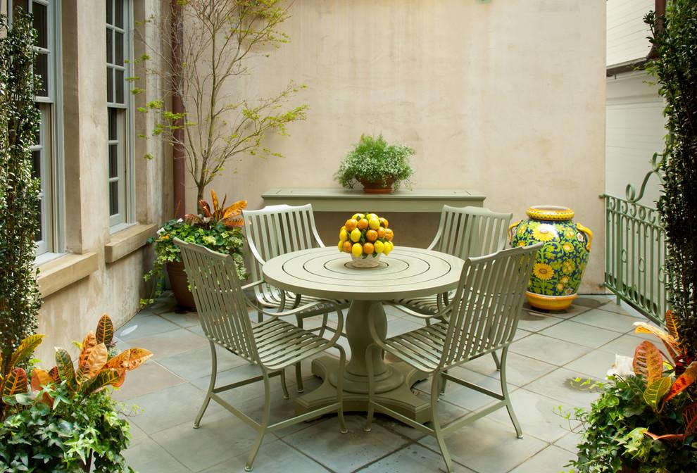 Trendy tile patio photo in Charleston