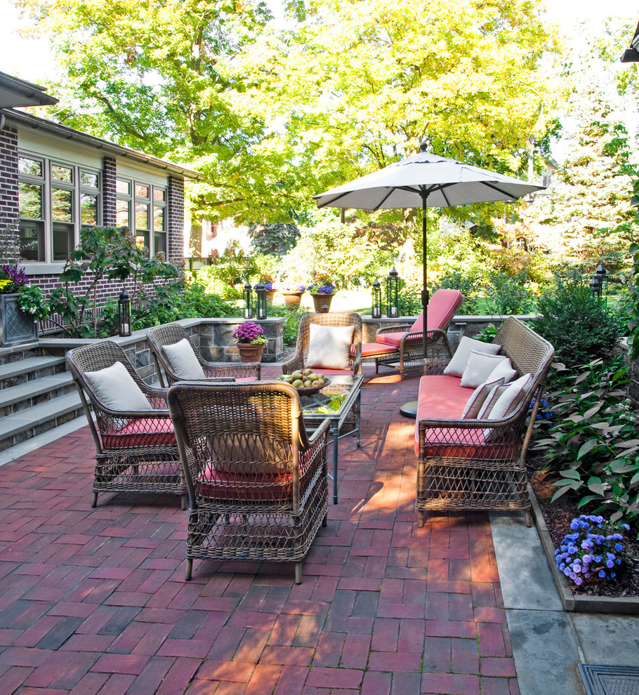 Mid-sized elegant backyard brick patio photo in Philadelphia with no cover