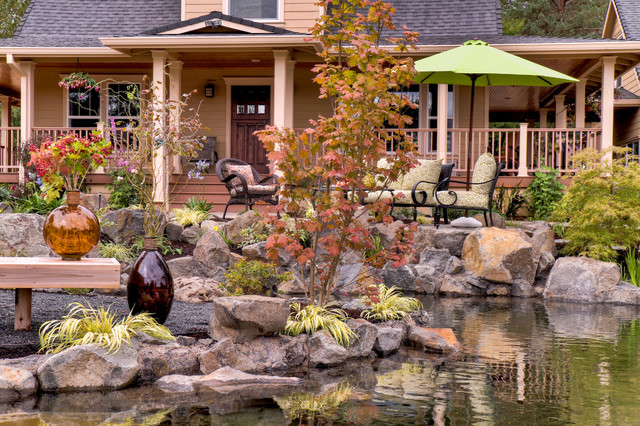 Dramatic pond with water fall traditional-patio