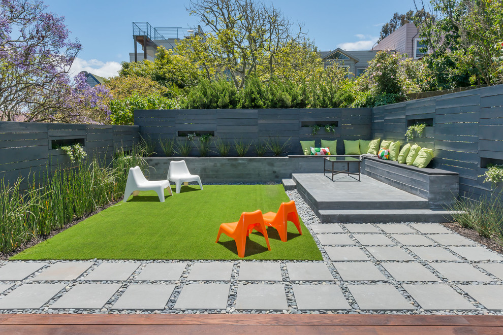 Trendy backyard concrete paver patio container garden photo in Houston with no cover