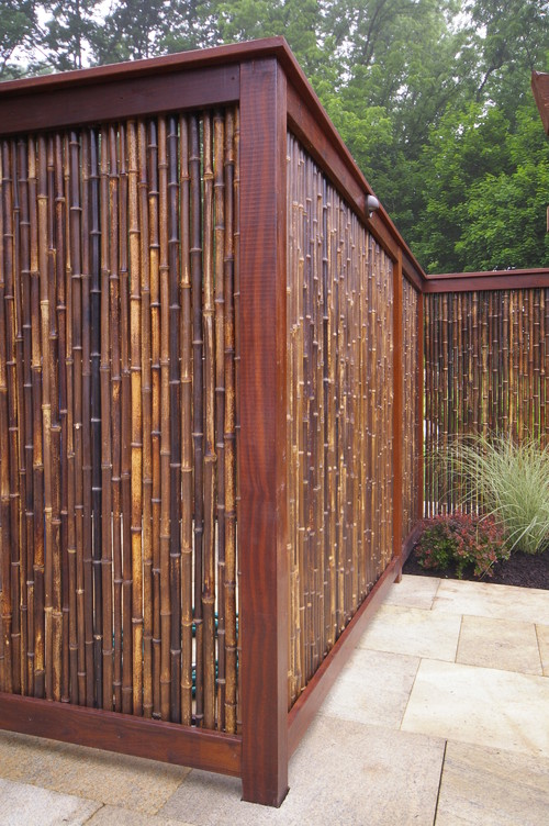 A beautiful and luxurious bamboo fence that shows off the many different shades bamboo can come in. Some stalks are mahogany, while others are the yellow natural color we usually expect from bamboo.