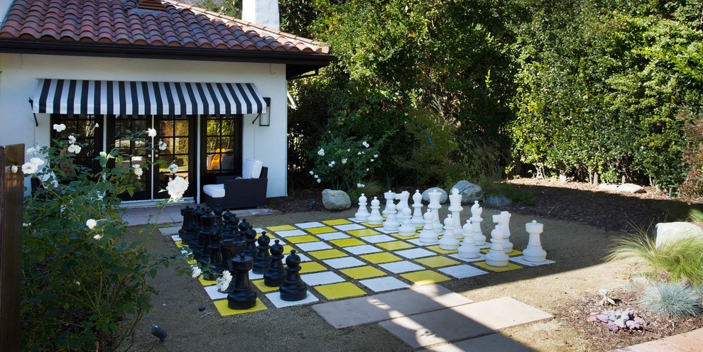 Patio - mid-sized eclectic side yard concrete paver patio idea in Los Angeles with no cover