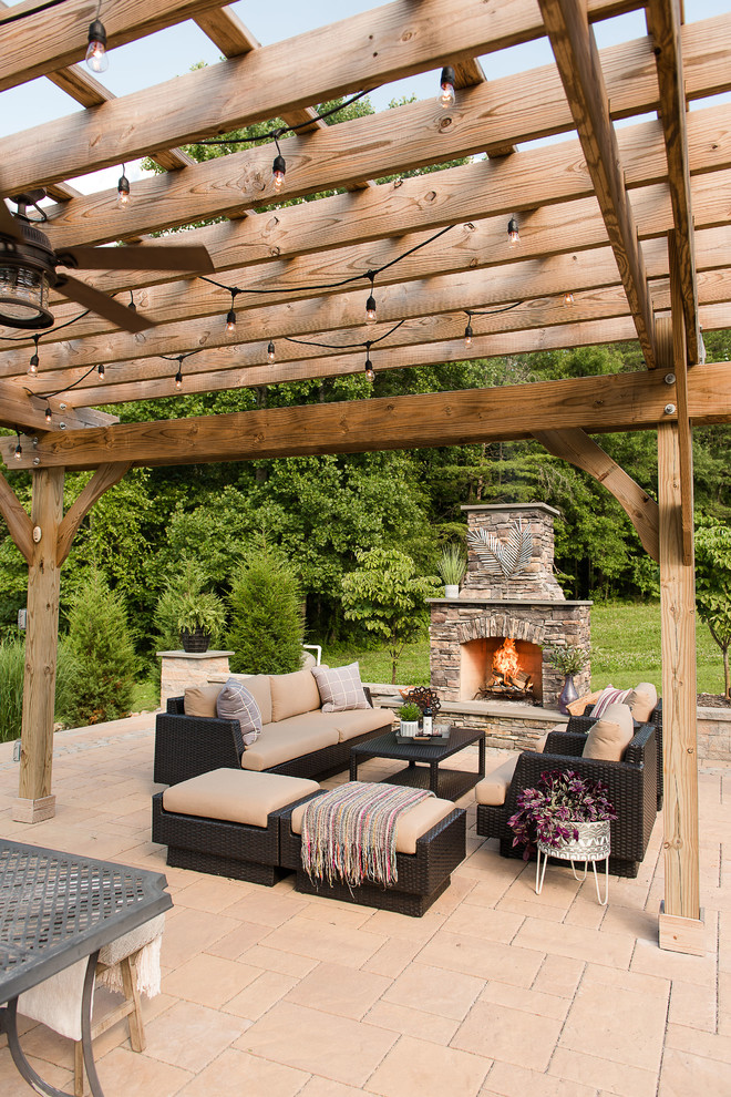 Large mountain style backyard concrete paver patio photo in Richmond with a fireplace and a pergola