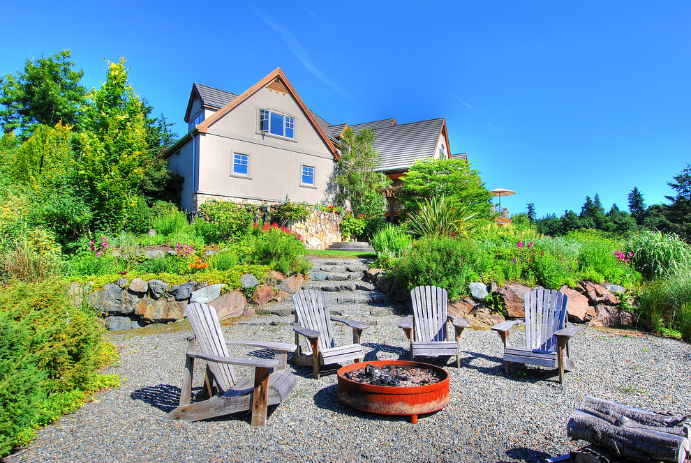 Large elegant backyard gravel patio photo in Seattle with a fire pit and no cover