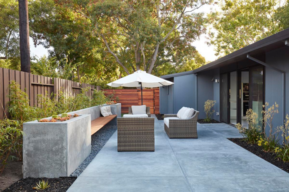 Inspiration for a mid-sized 1950s backyard concrete paver patio remodel in San Francisco with no cover