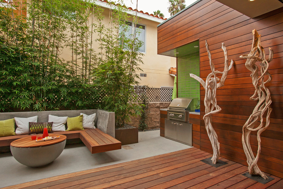 Large trendy side yard patio photo in San Diego with a fire pit, decking and no cover