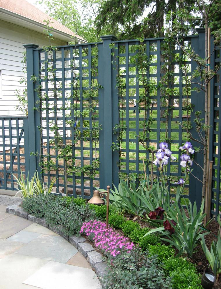 Example of a small classic backyard stone patio kitchen design in Newark