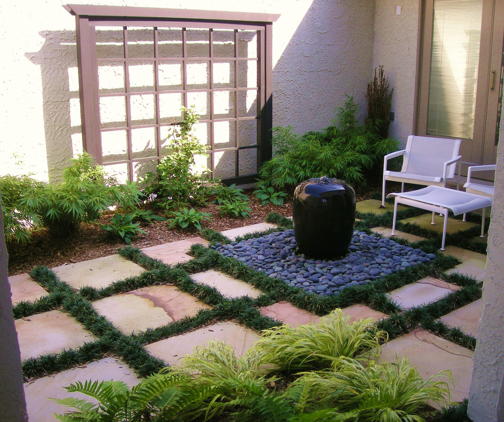 Example of a zen patio design in Newark