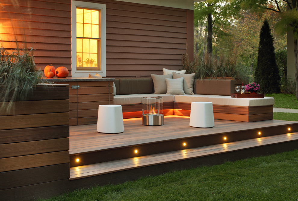 Inspiration for a transitional patio remodel in Other with a fire pit